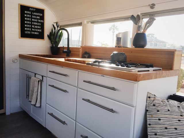 the essentials in our minimalist kitchen school bus conversion a